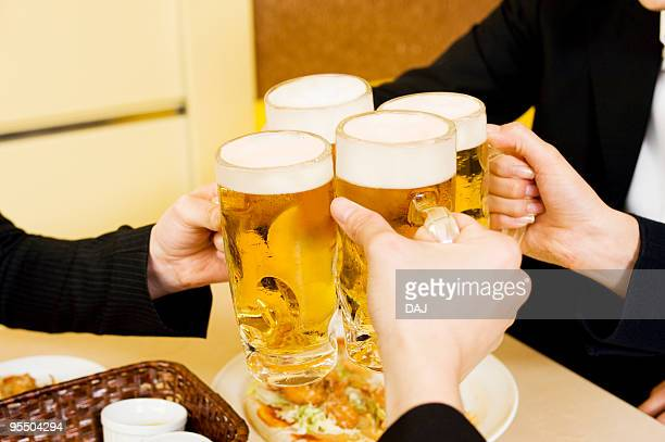 Group of young people toasting with beer