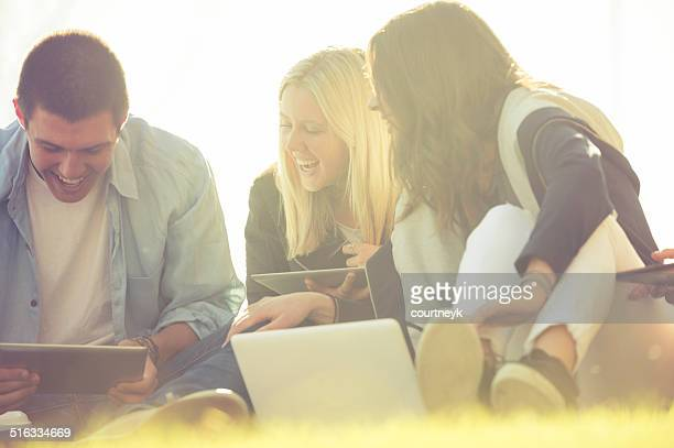 Group of young people using technology