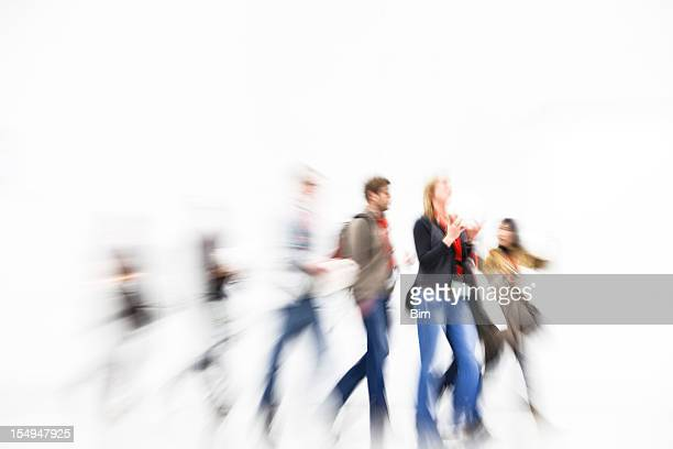 Group of young people walking and motion blurred