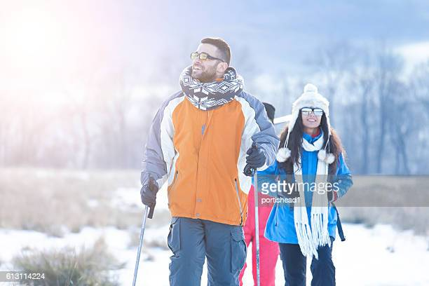 Group of young people walking in the snow mountain