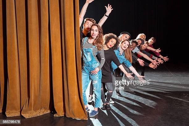 group of young performers on the stage - actor stockfoto's en -beelden