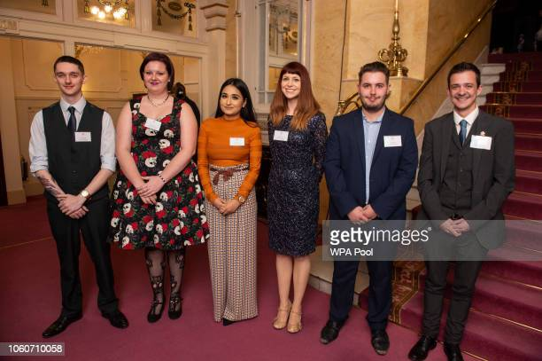 A group of young Prince's Trust beneficiaries wait to meet Prince Charles Prince of Wales and Camilla Duchess of Cornwall ahead of a one off...