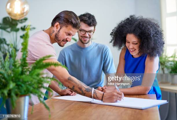 group of young professionals in brainstorming meeting - sleeveless dress stock pictures, royalty-free photos & images