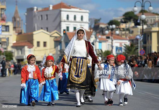 Group of young pupils wearing traditional costumes, march in front of the Government, Church and Army representatives, during the parade on the...