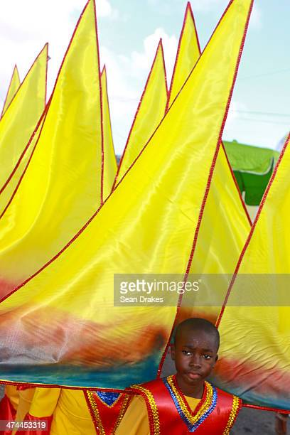 A group of young sailors perform at the Red Cross Junior Carnival competition on February 22 2014 in Port of Spain Trinidad Tobago