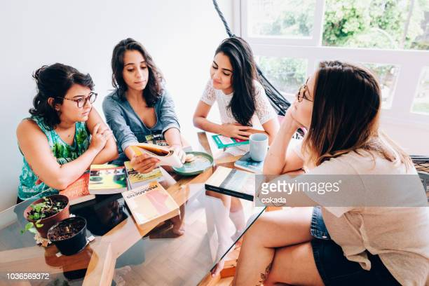 group young students studying at home