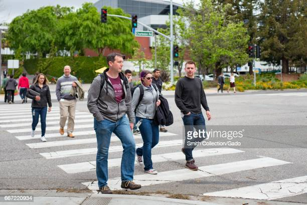A group of young technology workers cross Charleston Street at the Googleplex the Silicon Valley headquarters of search engine and technology company...