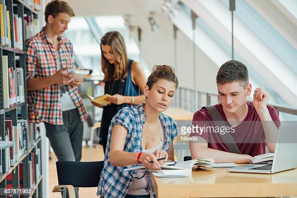 Group of young university students in casual wear in library