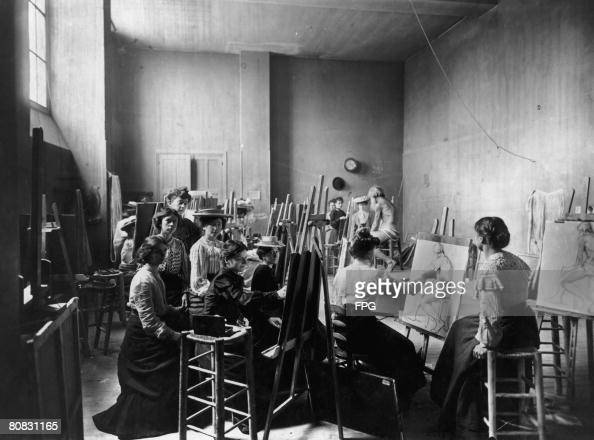 A group of young women artists sketching a nude male life