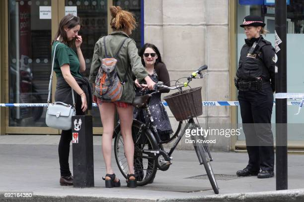 A group of young women at London Bridge following last night's terroris attack on June 4 2017 in London England Police continue to cordon off an area...