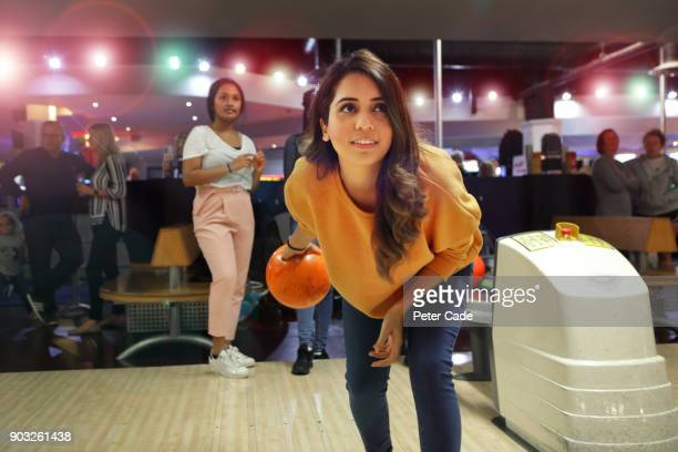 Group of young women bowling