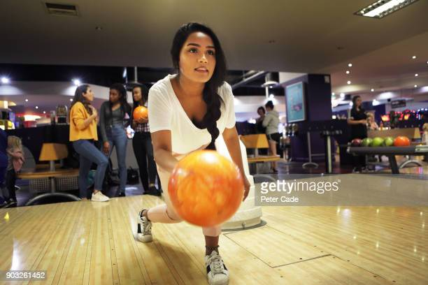 group of young women bowling - concentration stock pictures, royalty-free photos & images