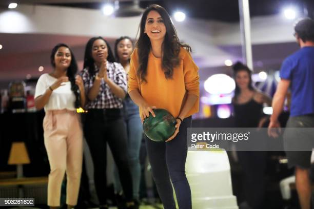 group of young women bowling - bowl stock pictures, royalty-free photos & images