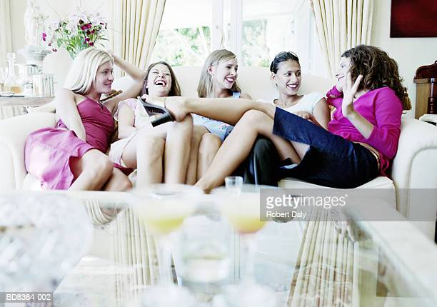 Group of young women chatting on sofa