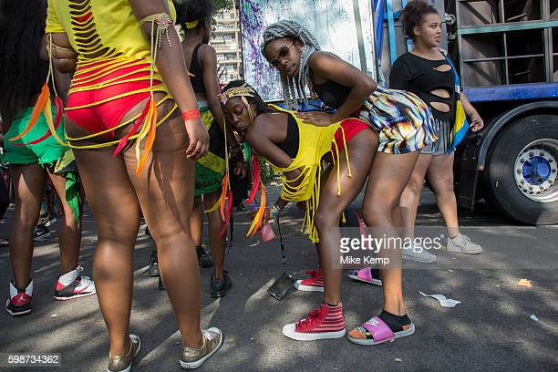 Group of young women daggering against a sound system truck on Monday 28th August 2016 at the 50th Notting Hill Carnival in West London This modern...