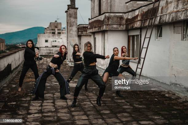 group of young women dancing on top of the building - competition group stock pictures, royalty-free photos & images