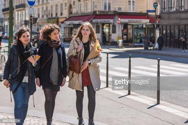group of young women friends walking in paris - french women stock photos and pictures
