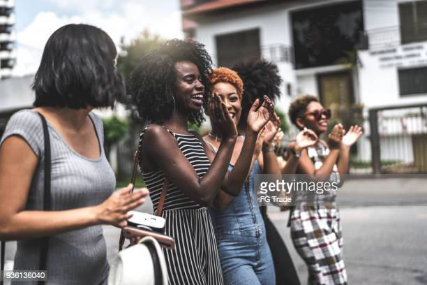 Group of Young women having fun together in the street