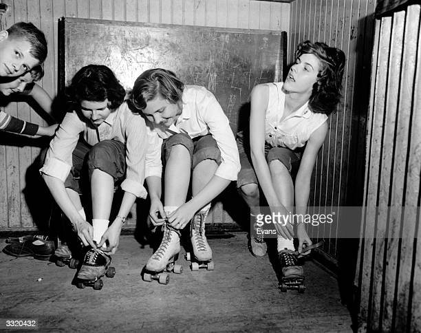 A group of young women putting their roller skates on at their Sunday School in Virginia