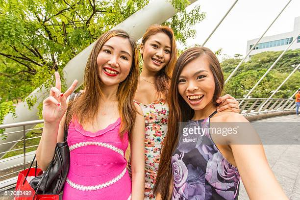 POV Group of Young Women Taking a Selfie in Singapore