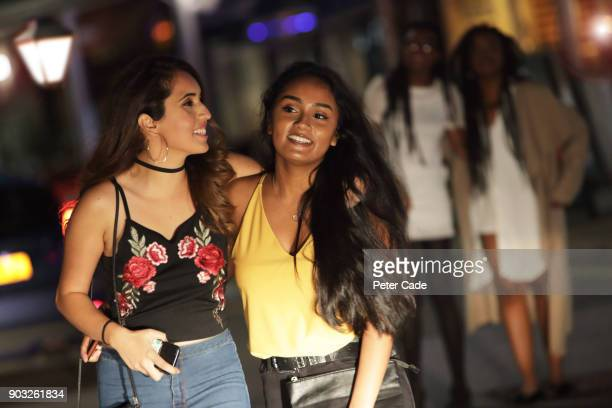 Group of young women walking outside on night out