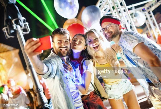 group of youngsters at a concert. - photo messaging stock pictures, royalty-free photos & images