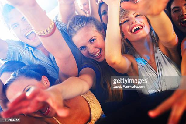 Group of youngsters enjoying at a disco