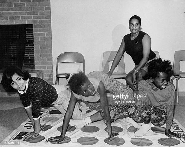 NOV 26 1969 DEC 10 1969 Group of Youngsters plays Game of 'Stretch' at Curtis Park Center Girls are from left Grina Gray 3047 Stout St Lisa and...