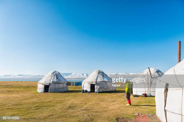 group of yurts at lake song kol - yurt stock pictures, royalty-free photos & images