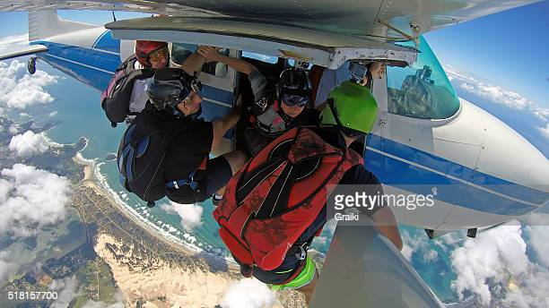 A group os skydivers ready to jump