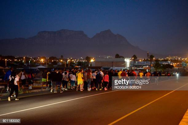 A group pf people including Cyril Ramaphosa the newly swornin South African president walk on an early morning from Guguletu township to Athlone...