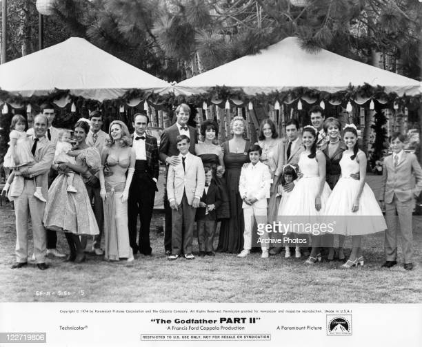Group photo of a portion of the cast at wedding in a scene from the film 'The Godfather Part II' 1974