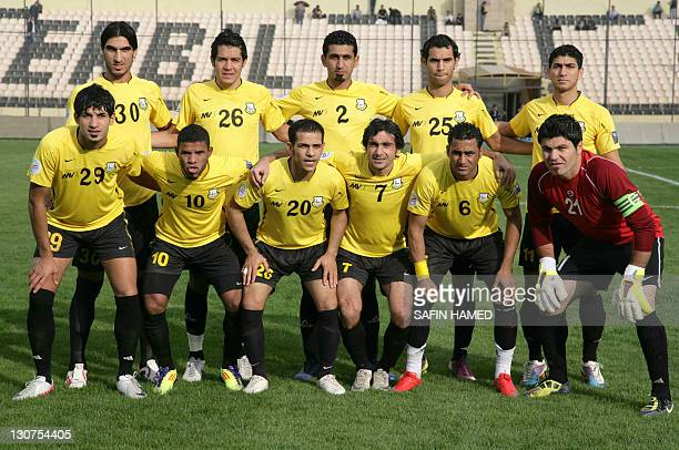 A group photo of Arbil's Club team members prior to their match against AlTalaba Club prior to the opening match of the Iraqi League football at the...