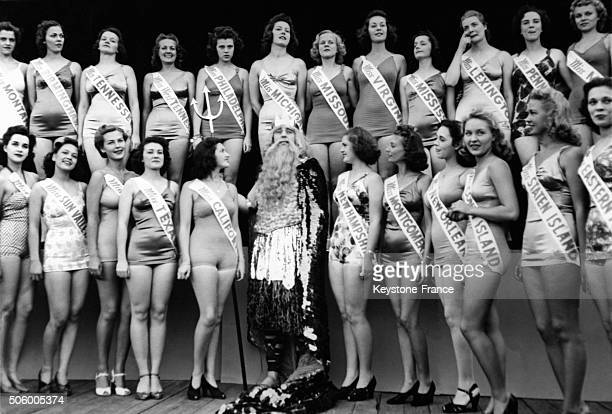 Group photo of candidates to the Miss America 1939 beauty contest, greeted by father Neptune, Bennett E Tousley, in Atlantic City, New Jersey, on May...