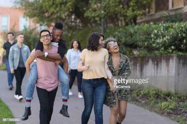group photo of college students on campus sidewalk together - gay rights stock pictures, royalty-free photos & images