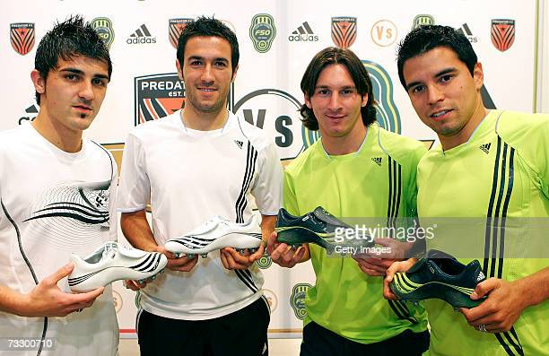 Group photo of David Villa Hugo Viana Lionel Messi and Javier Saviola presenting the new Adidas F50 boots at the Adidas Barcelona store on February...