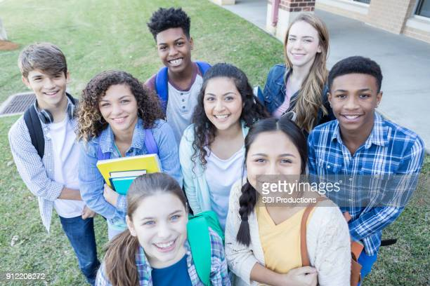 group photo of diverse high school friends - teenagers only stock pictures, royalty-free photos & images