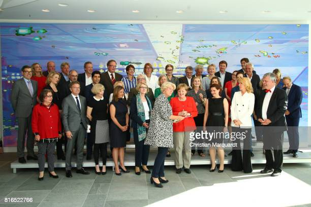 Group photo of the members of the round table 'Women In Culture And Media' including Angela Merkel Monika Gruetters , Maria Furtwaengler and the...