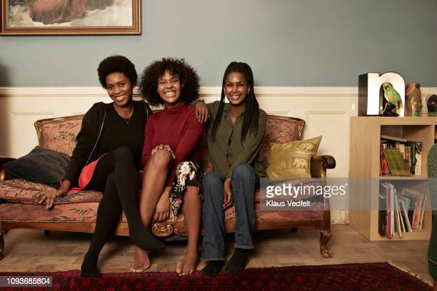 group photo of young women in sofa at home - adults only photos stock pictures, royalty-free photos & images