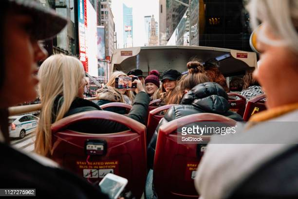group photo on tour bus - tourism stock pictures, royalty-free photos & images