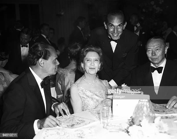 Group photo showing Valerain Rybar, Mrs. Elizabeth N. Graham also known as Elizabeth Arden, fashion designer Oscar de la Renta, and Alexander...