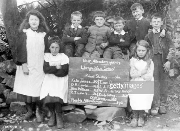 Group photograph containing those awarded for Best school attendence of Llangadfan School, Montgomeryshire, 1906-1907. Artist Unknown.