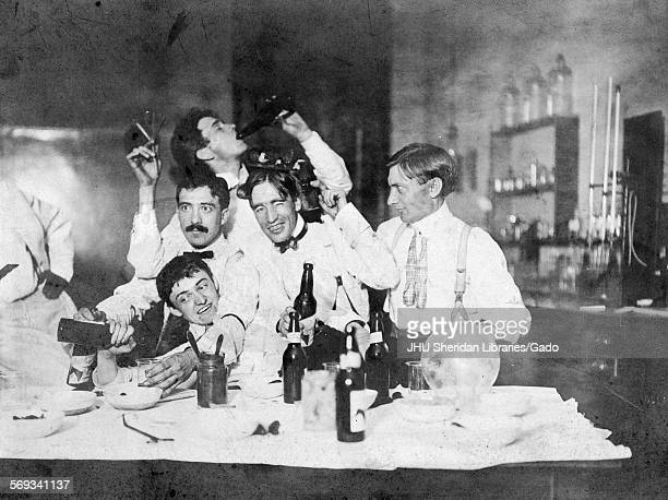 Group photograph of 1901 Chemistry PhDs drinking smoking and engaging in frivolities in laboratory at Johns Hopkins University Baltimore Maryland...