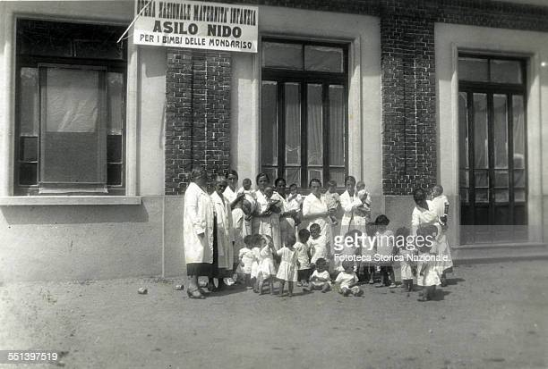 Group photograph of assistants and the children of the Kindergarten for children of the women workers on rice National Opera Maternity and childhood...