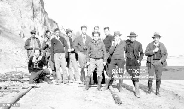 Group photograph of geology students at Johns Hopkins University on top of a large stone structure with cliffs behind them in the background 1921