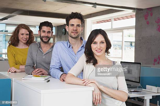 group picture of four creative people in the office - four people stock pictures, royalty-free photos & images