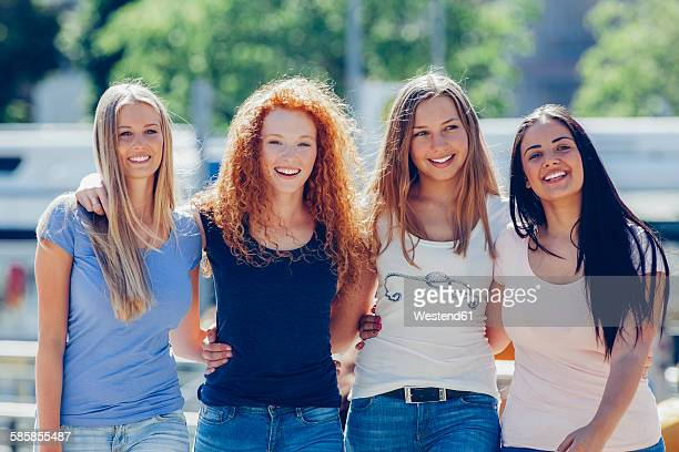 Group picture of four friends on the street