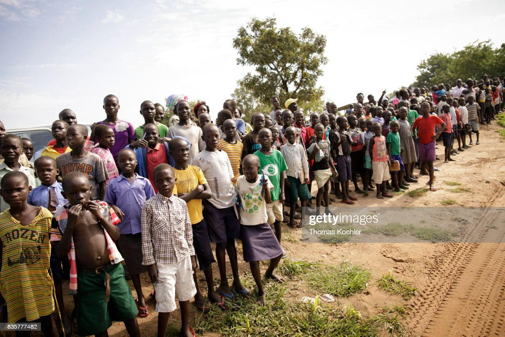 Refugees at the Rhino Refugee Camp Settlement : News Photo