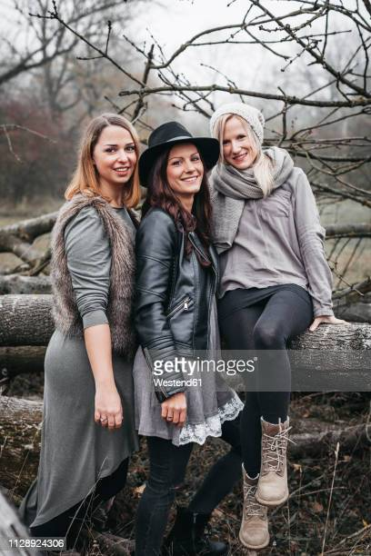 Group picture of three friends in autumnal nature