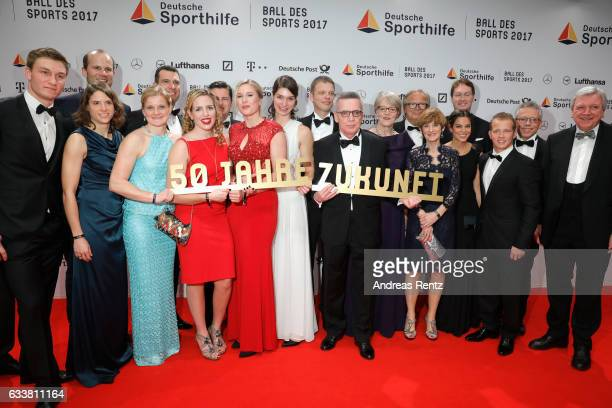 Group picture of various guests holding a sign '50 Jahre Zukunft' at the German Sports Gala 'Ball des Sports 2017' on February 4 2017 in Wiesbaden...